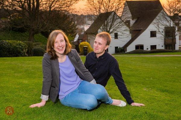 engagement shoot couple sitting on grass portrait photography Chris Mann