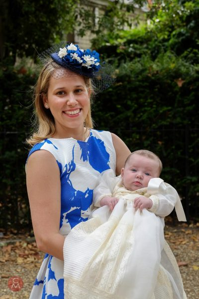 proud mother holding baby christening baptims portrait photography Chris Mann