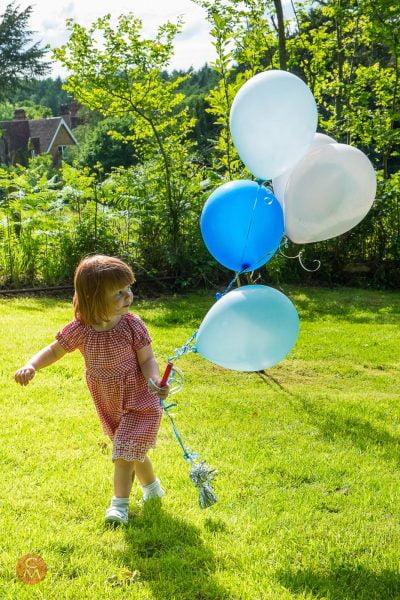 happy child with balloons sunshine garden portrait photography Chris Mann