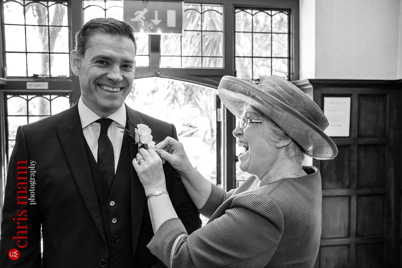 mother pins boutonniere on groom at Weybridge Register Office wedding