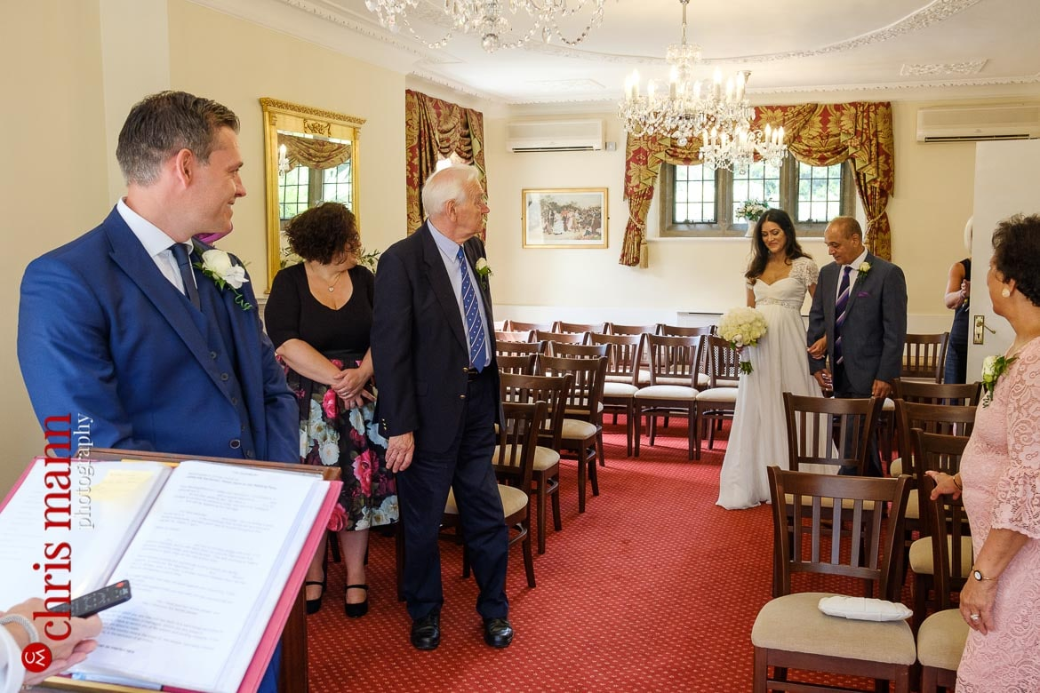 bride and father walk down the aisle for Weybridge Register Office wedding