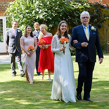 bride with father wedding party walk down for outdoor wedding surrey UK