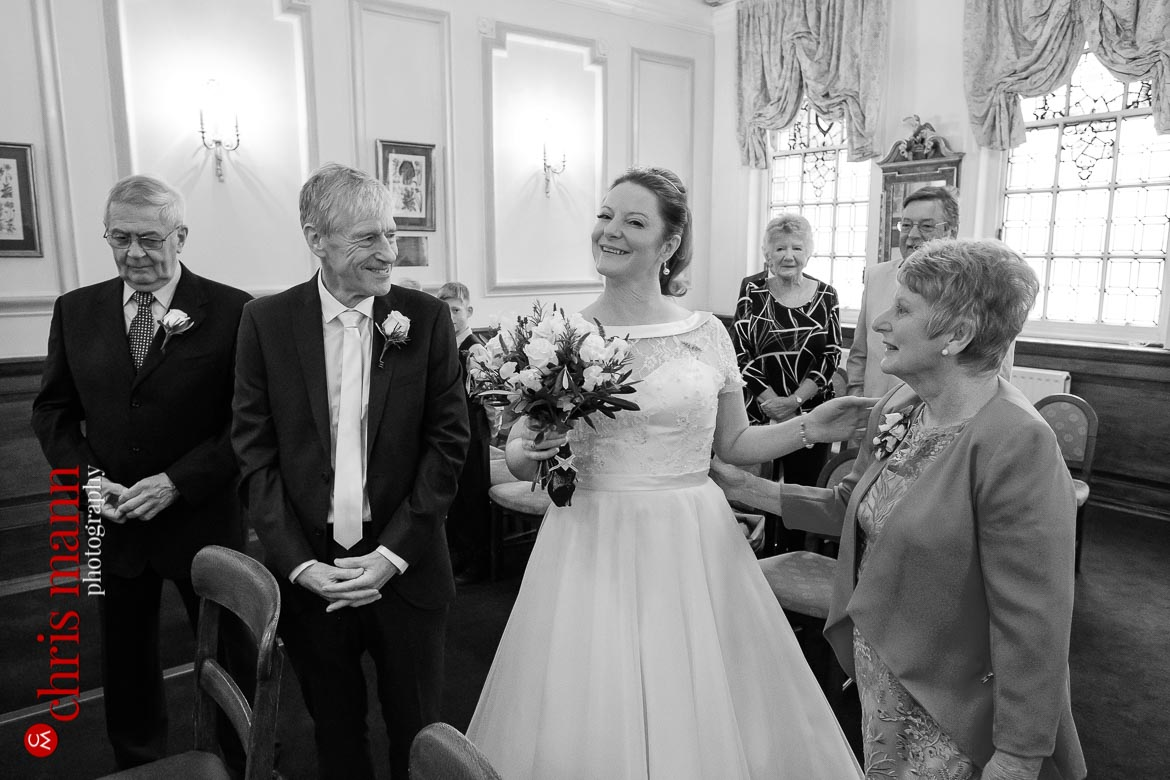 bride and mother enter Dexter Room for Oxford Register Office Wedding