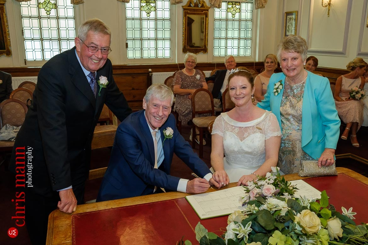 bride and groom with witnesses at Oxford Register Office Wedding