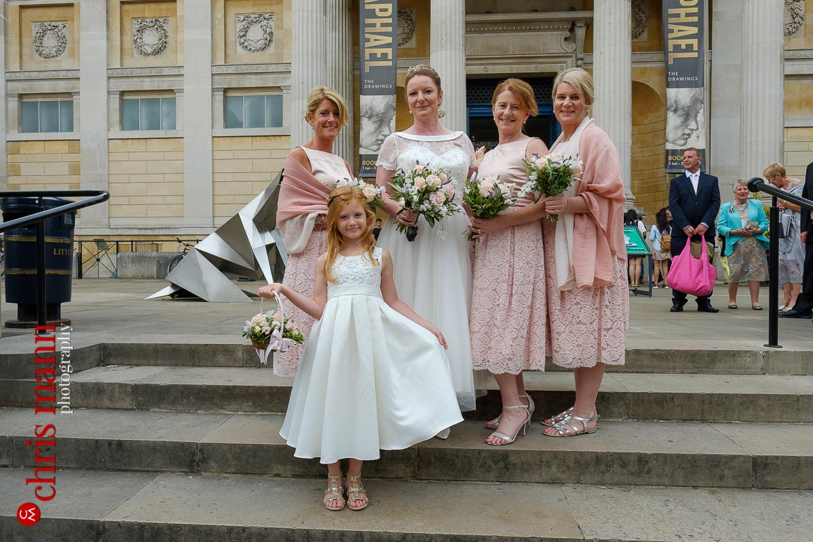 brdie with bridesmaids on steps of Ashmolean Museum Oxford
