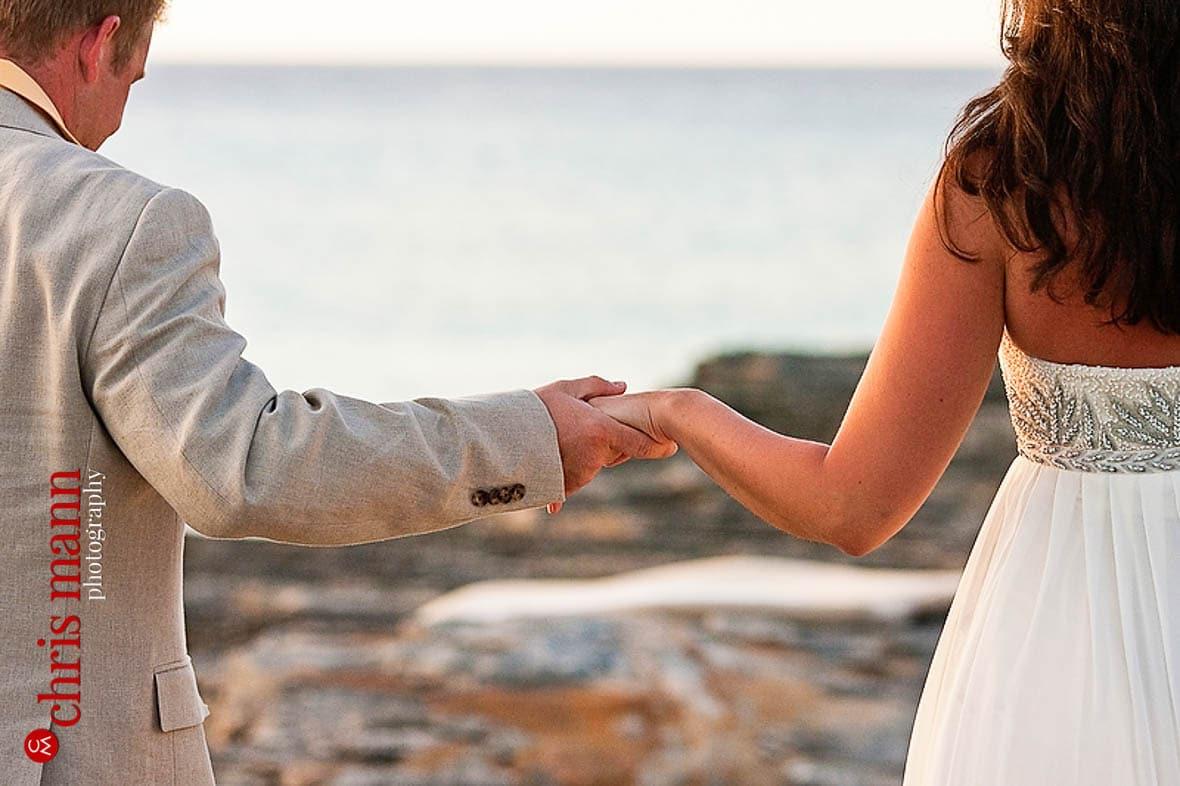 Turks & Caicos honeymoon shoot couple holding hands Amanyara resort Providenciales