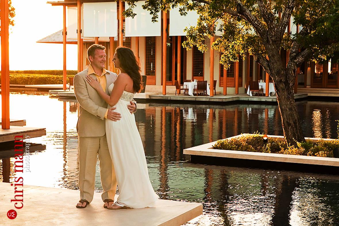 Turks & Caicos honeymoon shoot couple embracing by reflecting pool Amanyara resort Providenciales