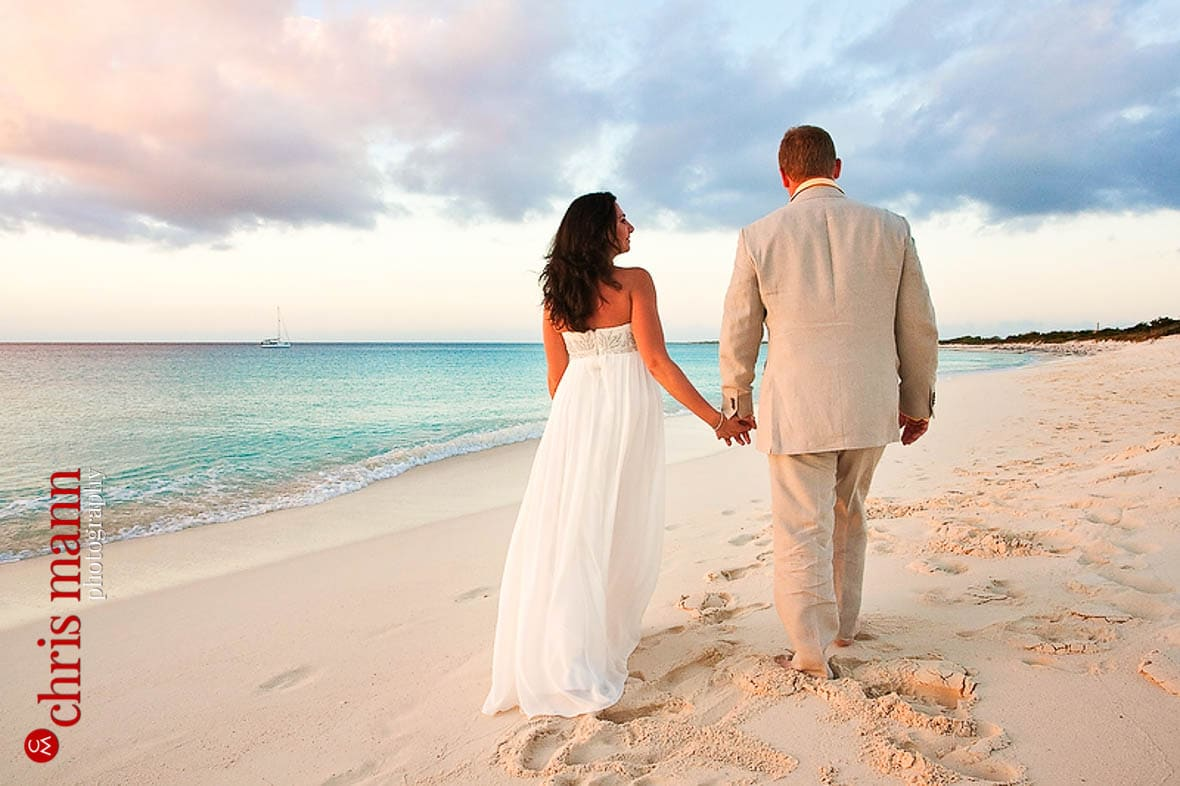 Turks & Caicos honeymoon shoot couple walking on Malcolm's Road beach Amanyara resort Providenciales