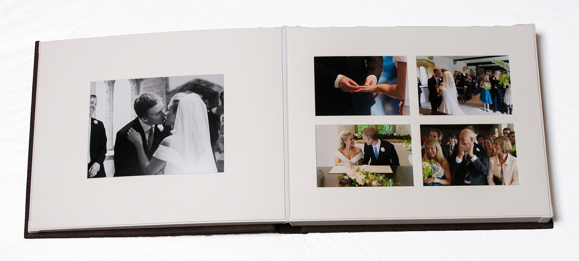 Deluxe matted album double-page spread showing white mats