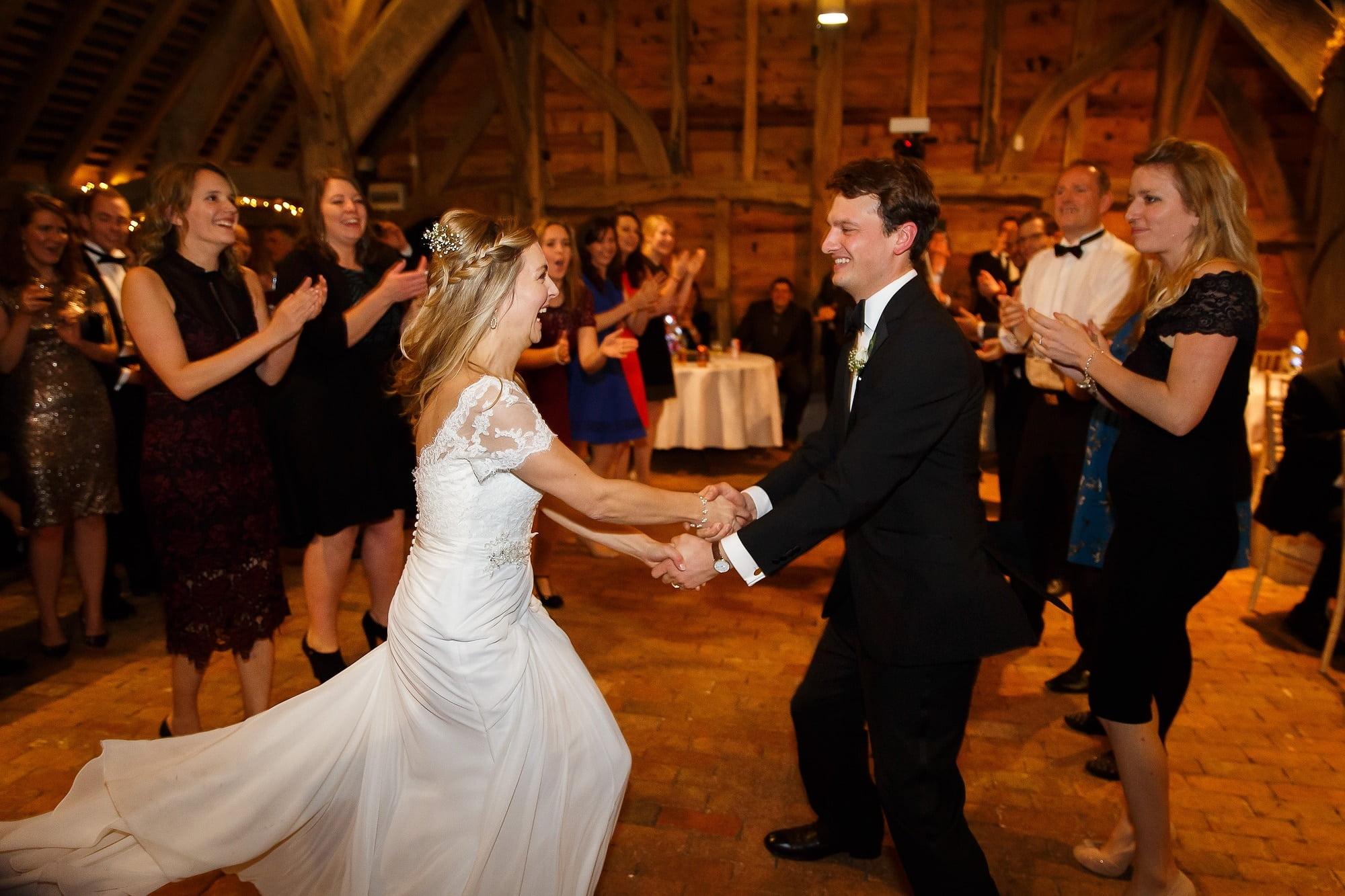 Surrey wedding photography couple dancing Gildings Barn Chris Mann Photography