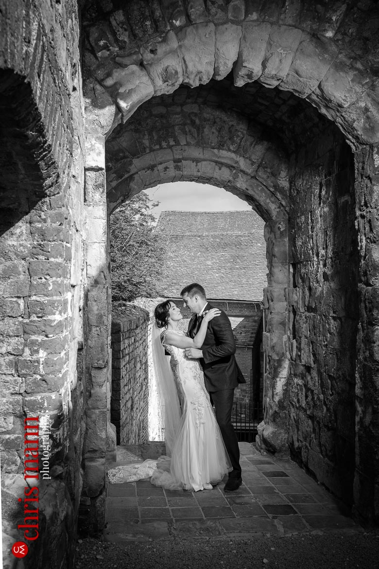couple in the Keep gateway at Farnham Castle anniversary shoot