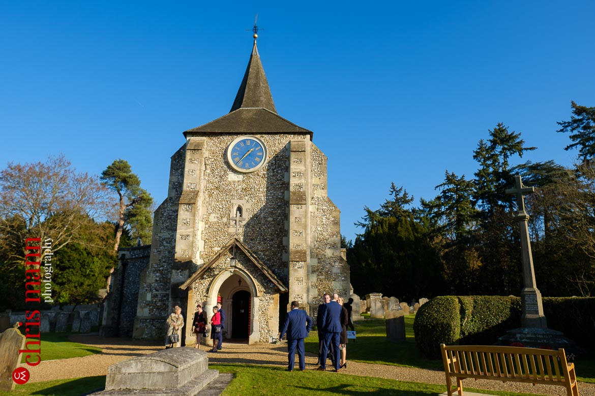 Mickleham Church Box Hill wedding - outside the church in the sunshine as guests arrive