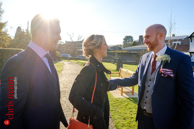 Mickleham Church Box Hill wedding groom greets quests