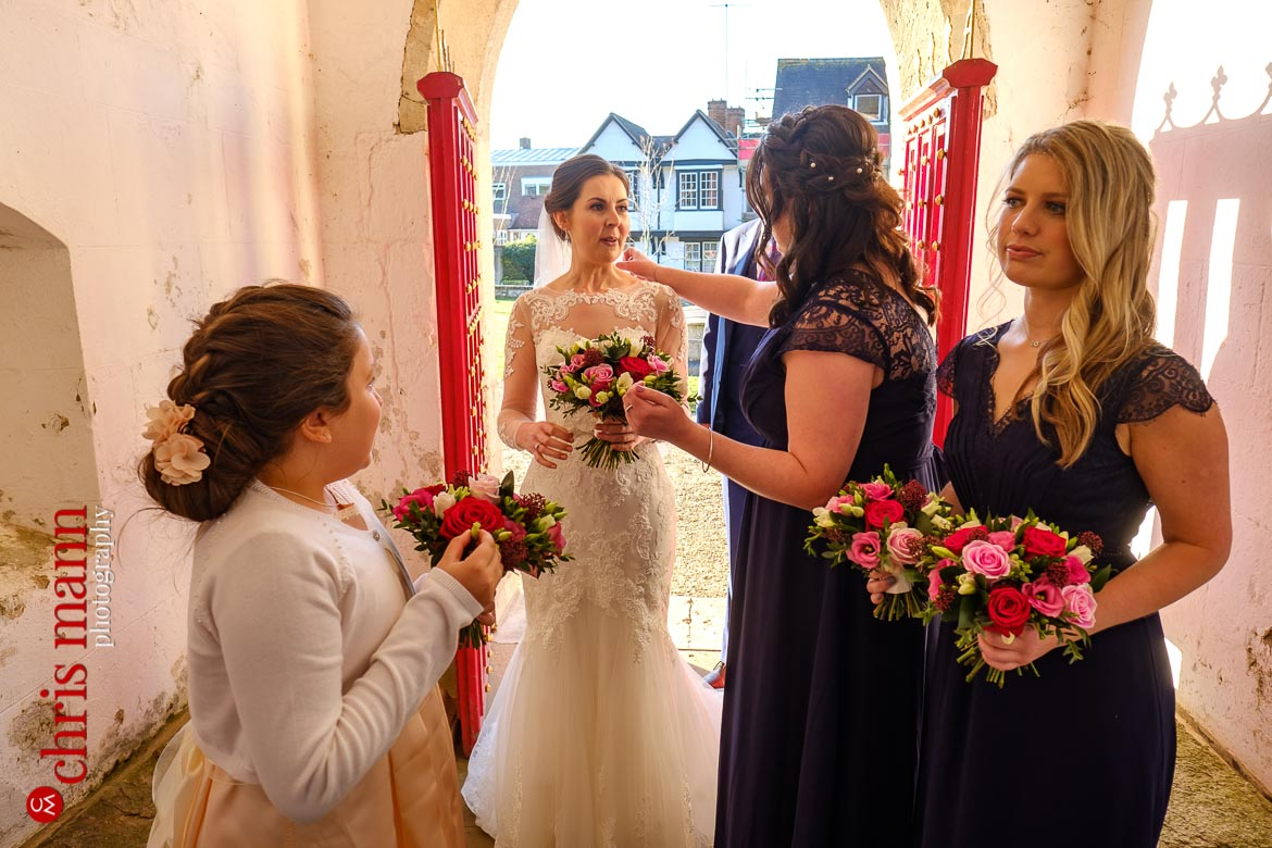 Mickleham Church Box Hill wedding bride and attendants in church porch