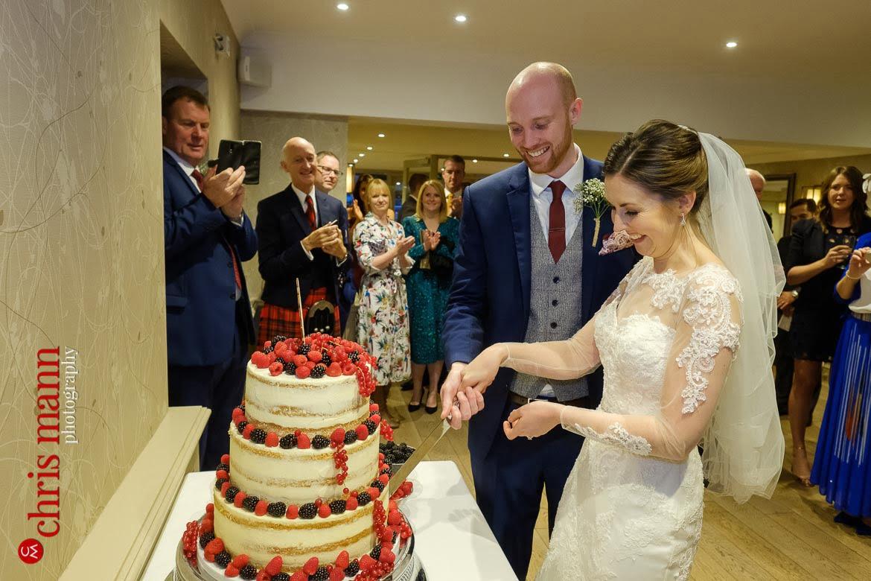 Mercure Burford Bridge Hotel Box Hill Dorking - bride and groom cut the cake