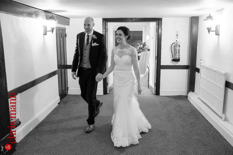 Mercure Burford Bridge Hotel Box Hill Dorking - bride and groom enter Tithe Barn for wedding breakfast