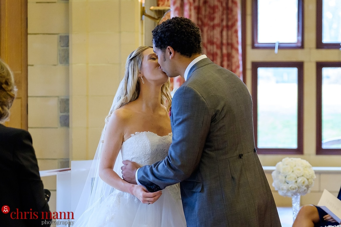 couple's first kiss - South Lodge Horsham wedding photography by Chris Mann