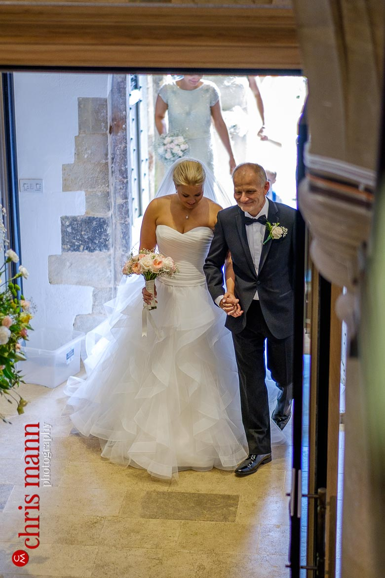 bride arrives on her father's arm - Hampshire country church wedding - St Peter's Bishop Waltham