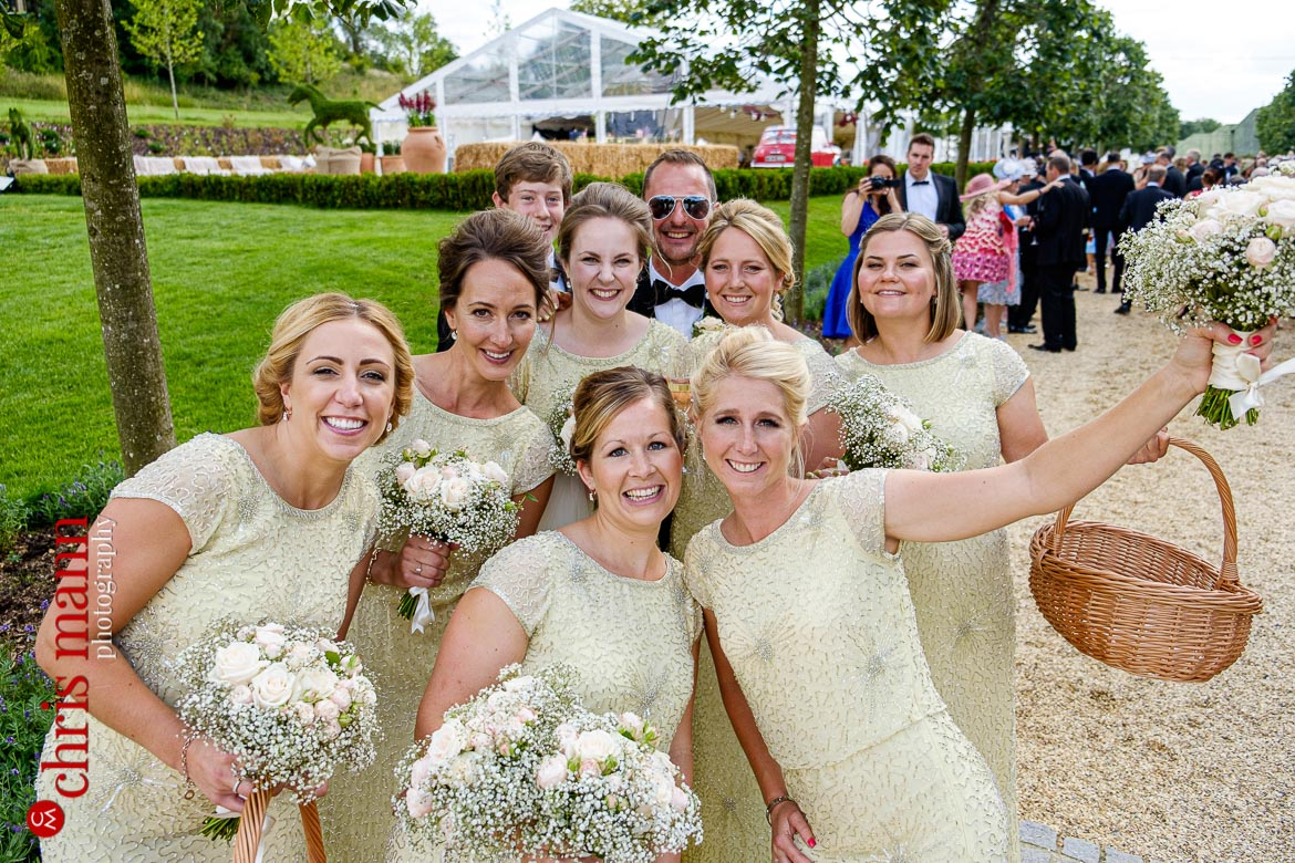 happy bridesmaids with bouquets at an English country wedding