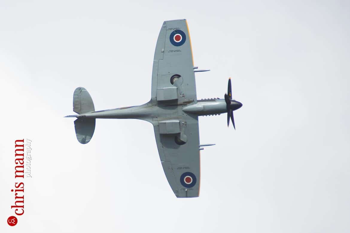 closeup view of a Supermarine Spitfire Mk XIV as it files over a wedding reception