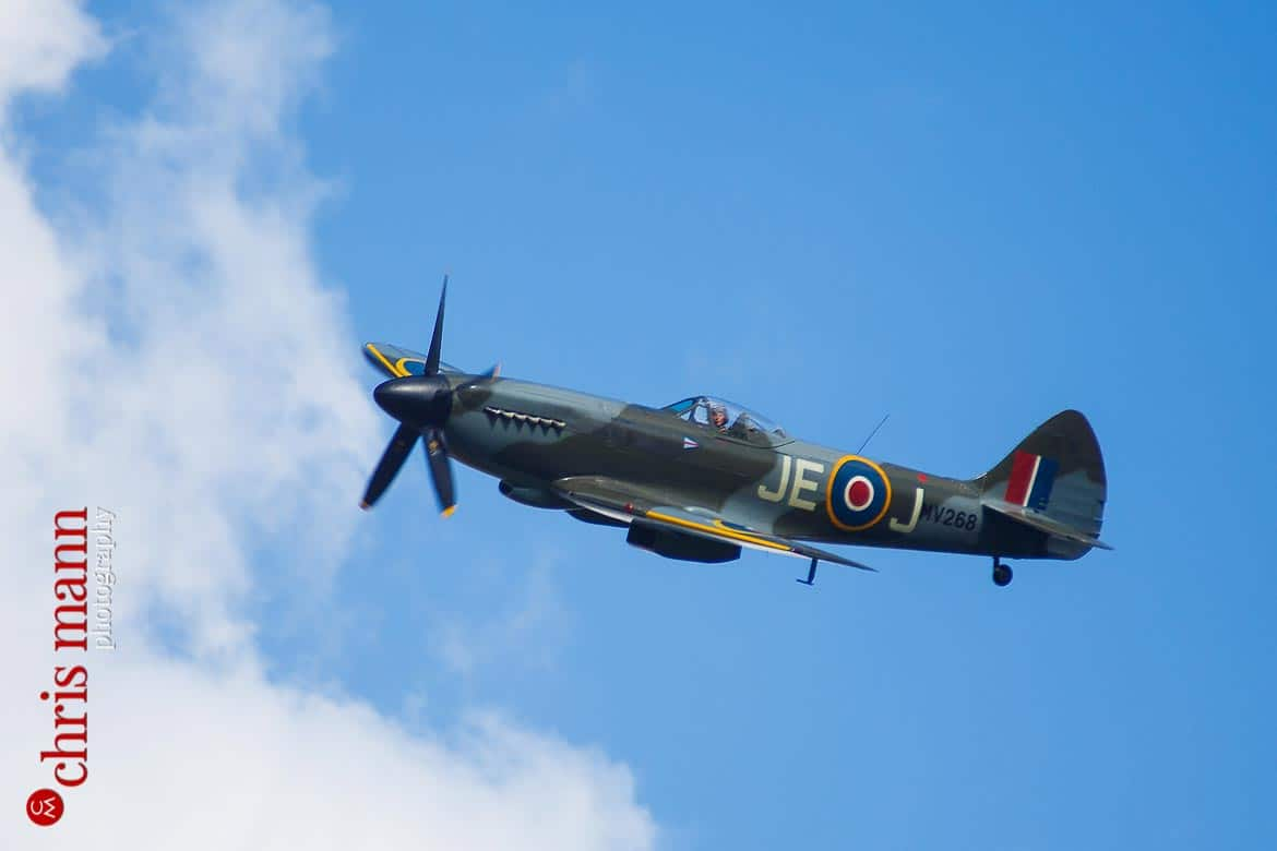 closeup view of a Supermarine Spitfire Mk XIV flying over a wedding reception in Hampshire