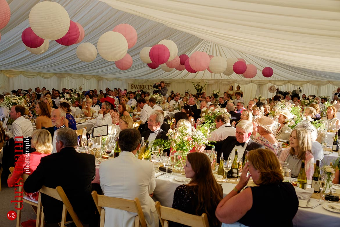 wedding guests enjoying the speeches in the marquee at a Hampshire country wedding