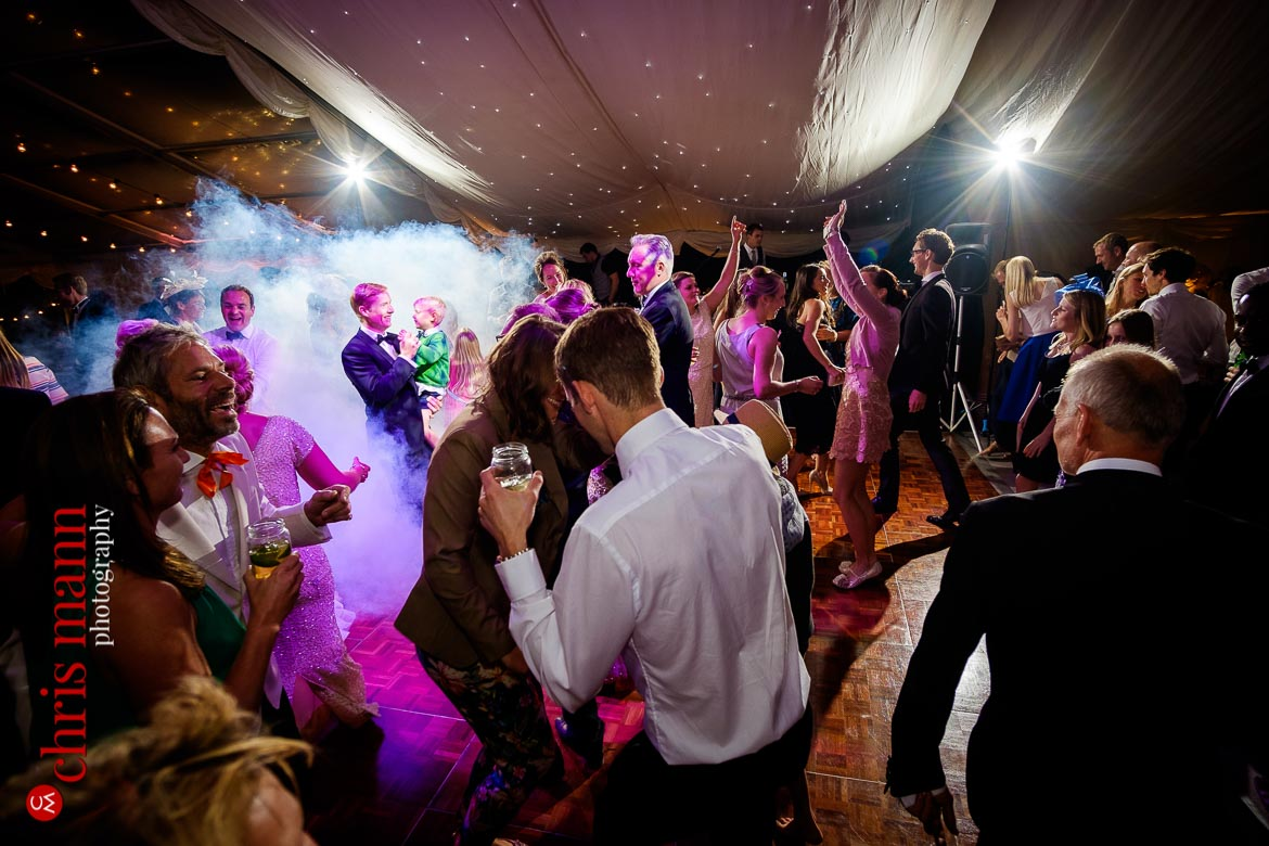 guests having a great time on the dance floor at an English marquee wedding reception