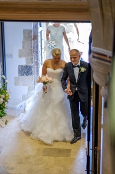 bride arrives at church with her father