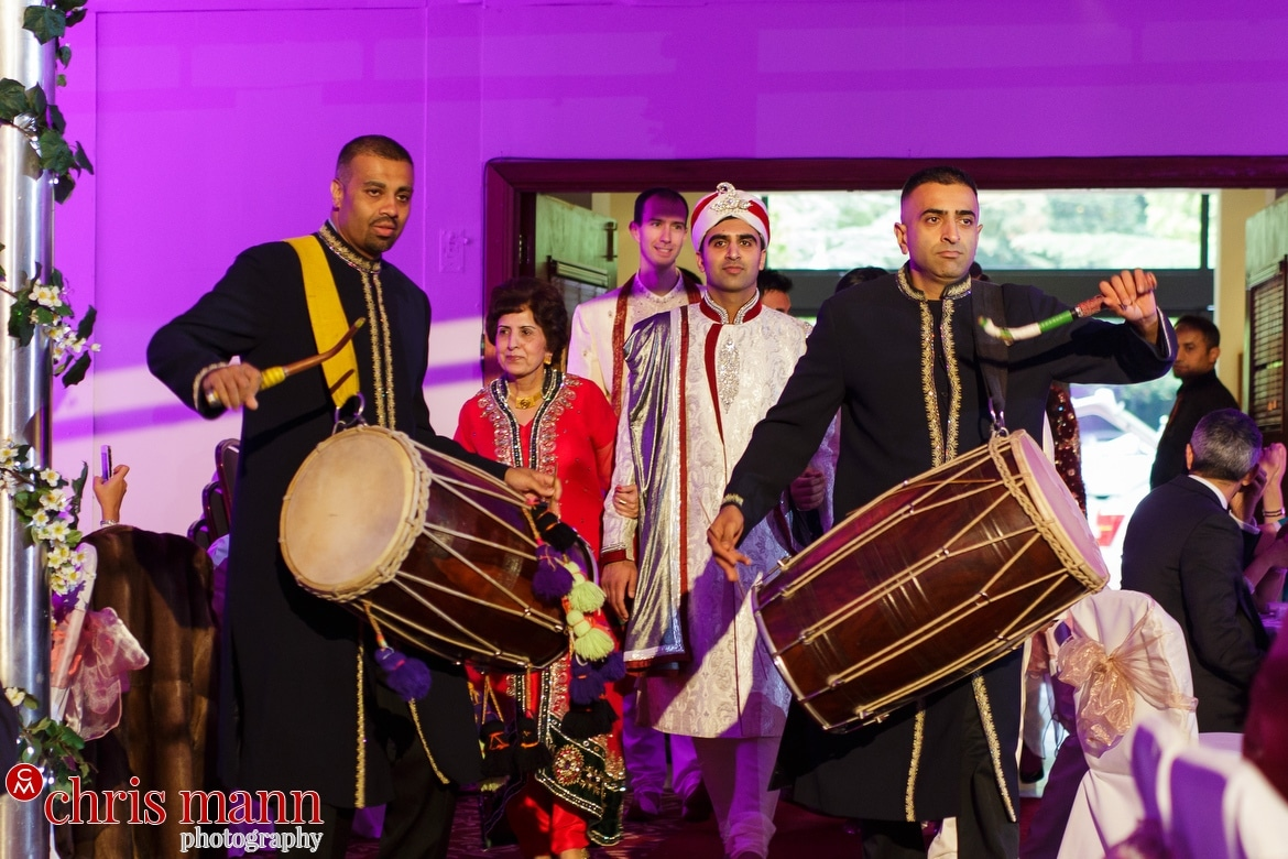 Dhol drummers lead in the groom at Fairmont Windsor Muslim wedding