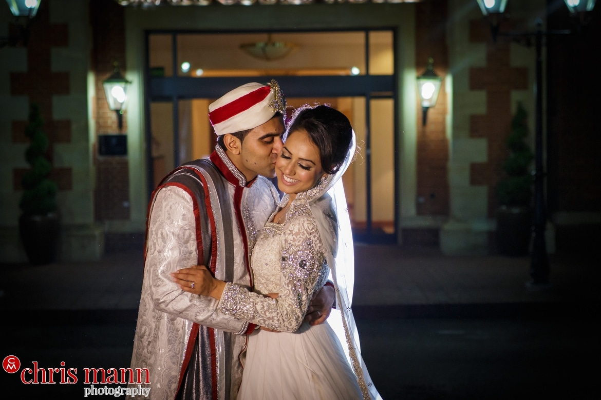 nighttime portrait of bride and groom at Fairmont Windsor Muslim wedding