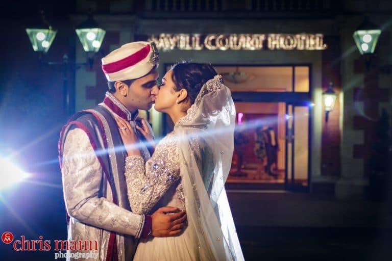 Fairmont Windsor Muslim wedding couple embrace outside hotel