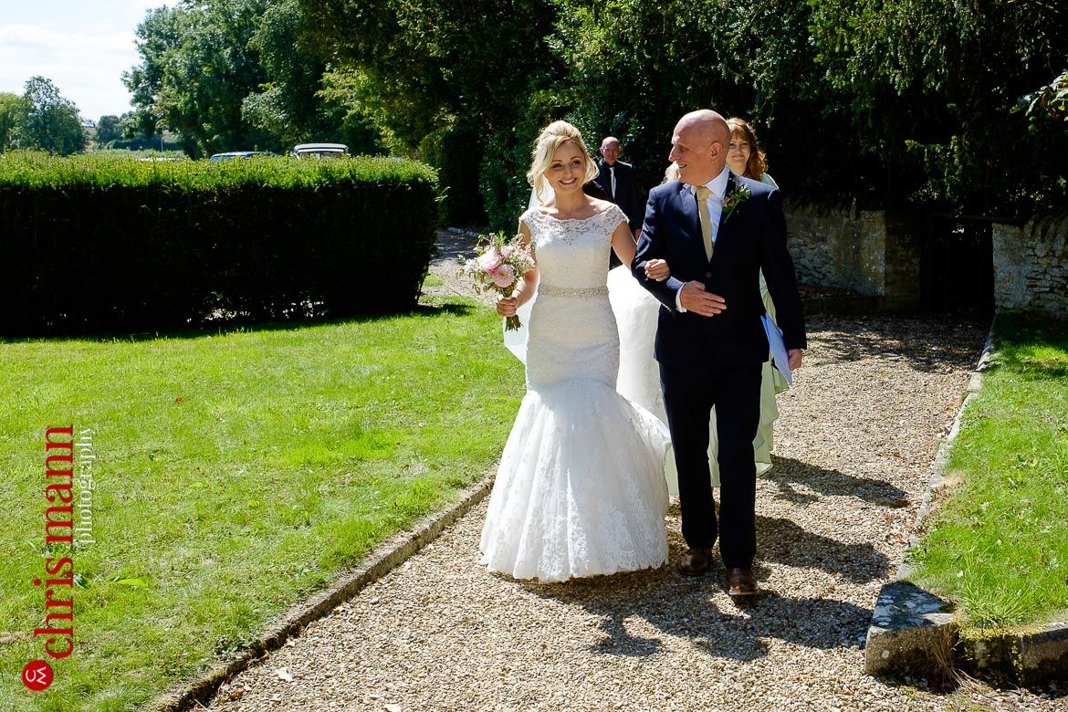 Bride and father walk to the church - Oxfordshire country wedding