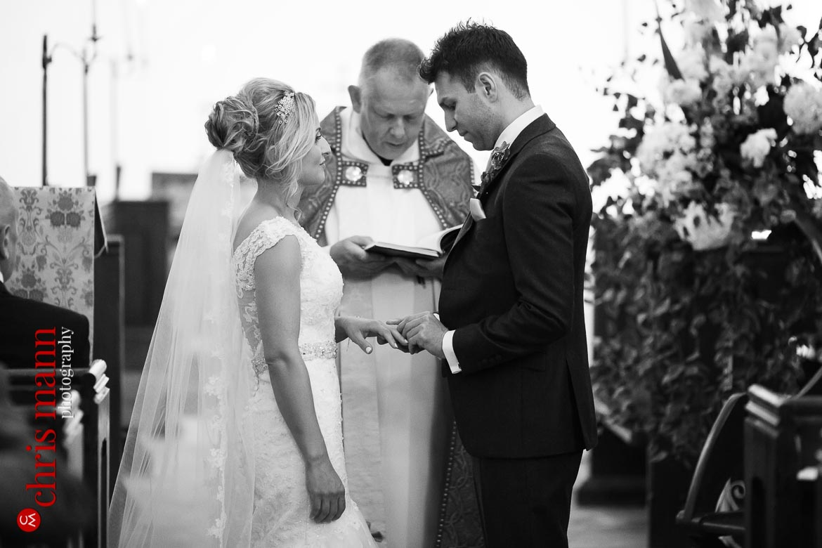 couple exchange rings at church wedding ceremony in Oxfordshire