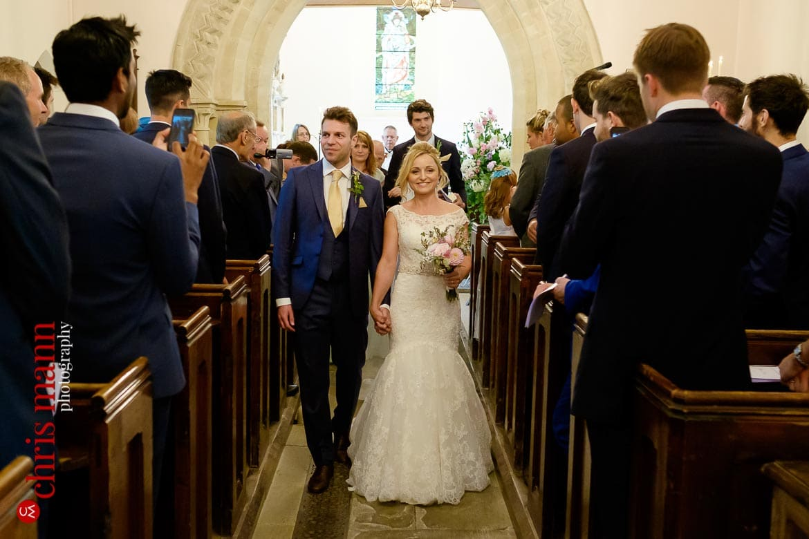 bride and groom process down the nave at St Mary's Church Buscot - Oxfordshire country wedding