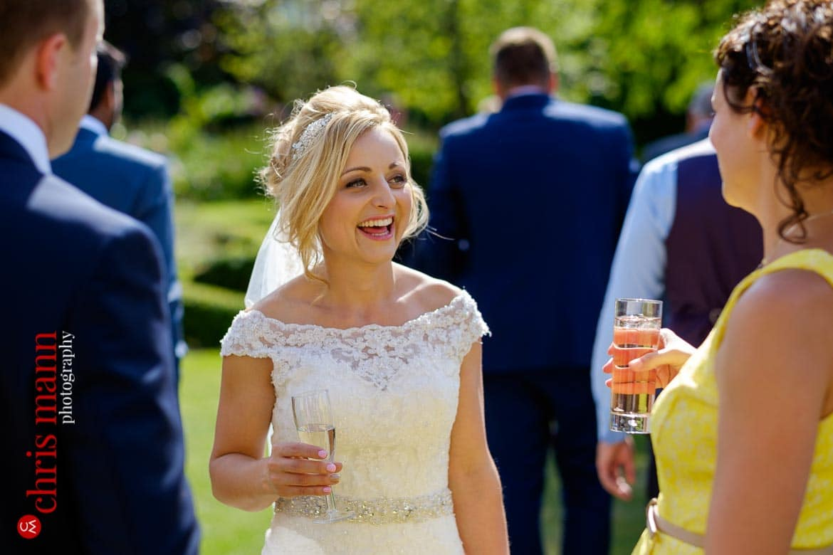 launghing bride at wedding reception - Oxfordshire country wedding