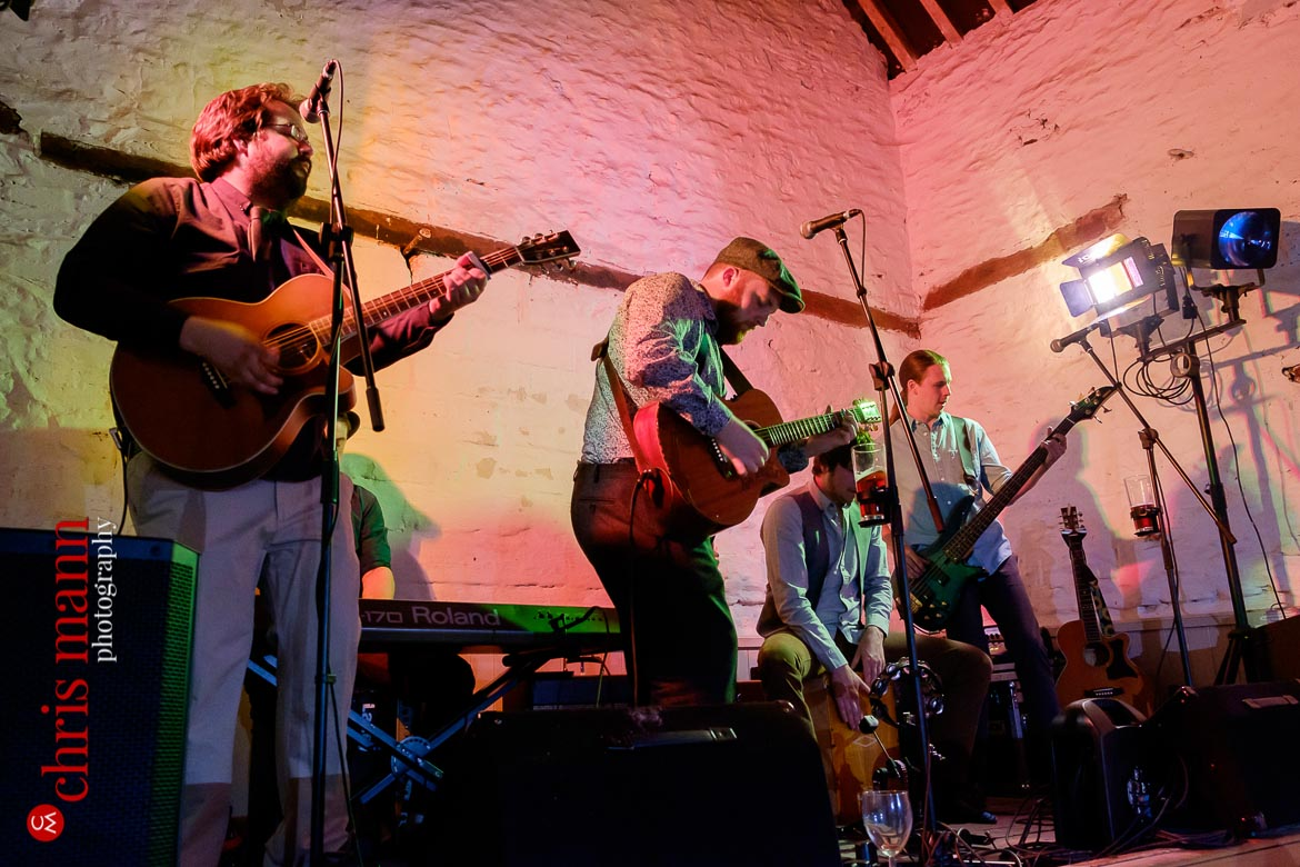 band performs at Friar's Court stone barn wedding venue Oxfordshire