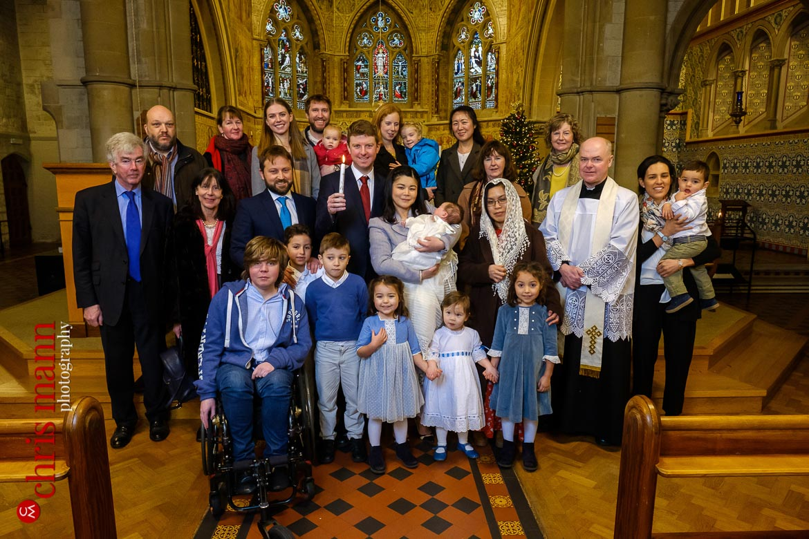 family group photo after christening ceremony at Sacred Heart Church Caterham