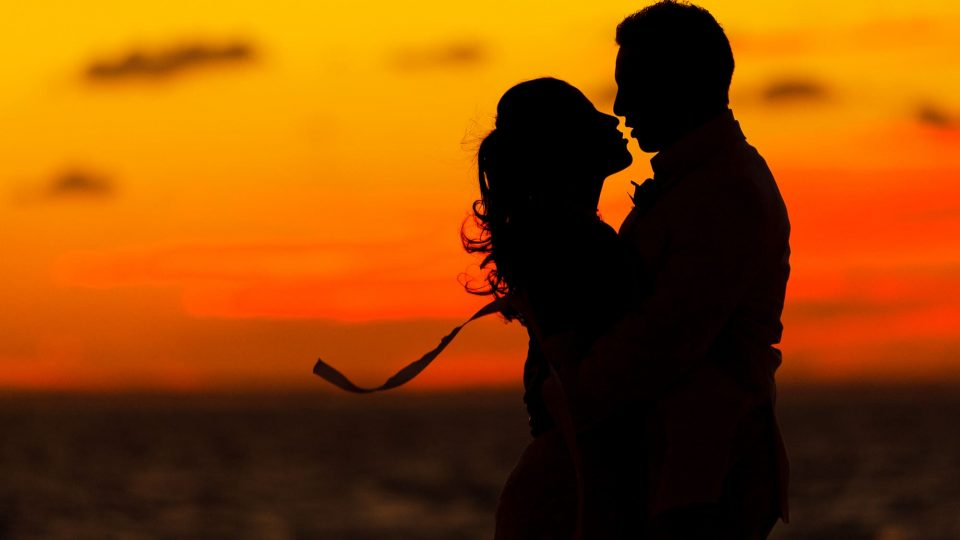 Bride and groom sunset silhouette on Grace Bay beach, Turks & Caicos Islands BWI