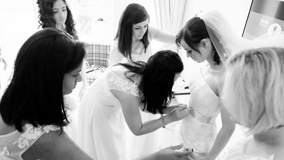 bridal preparations bride and bridesmaids photo by Guildford Surrey wedding photographer Chris Mann